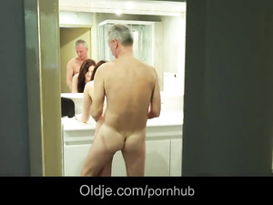 Mature man hotly fucks young busty brunette chick in bathroom