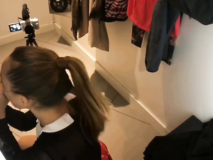 Pretty young brunette enjoys hot fuck in dress room