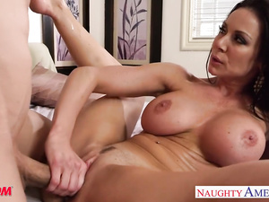 Beautiful brunette Kendra Lust is doing deepthroat blowjob before getting fucked hard